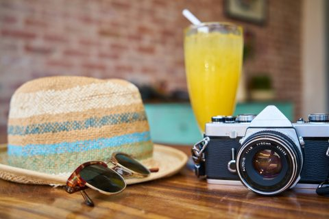 Dreaming of annual leave'; hat, sunglasses and camera